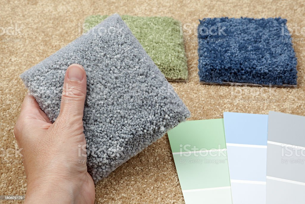 Home Decorating Choosing Carpet Samples And Paint Colors stock ...