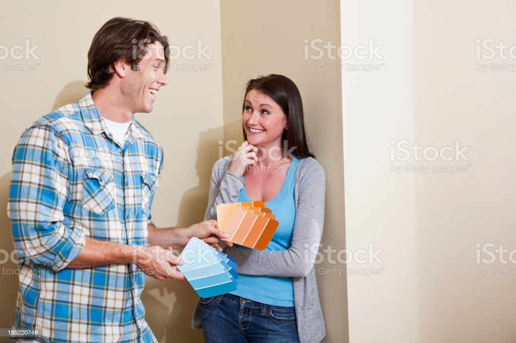 Home decorating - couple looking at paint chips stock photo