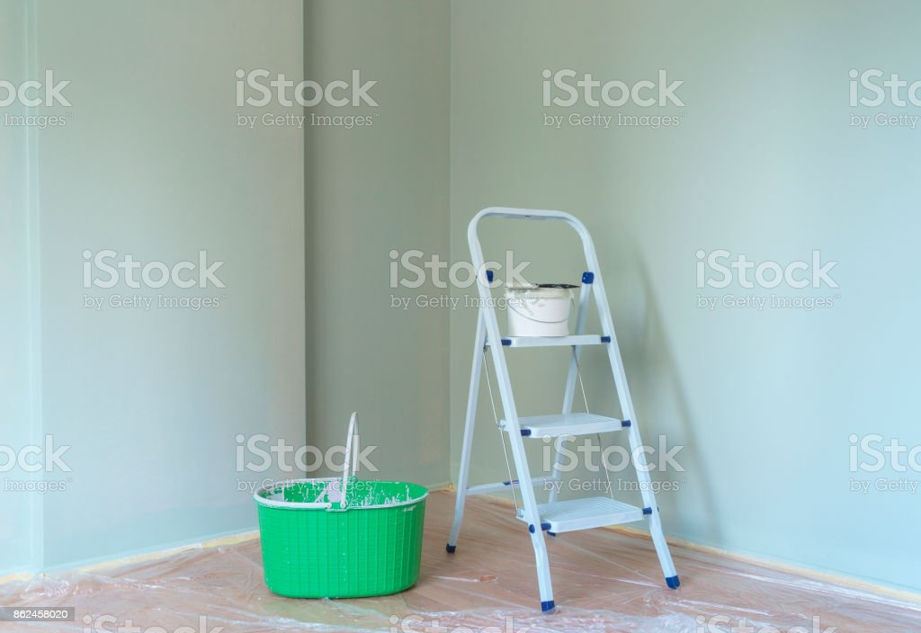 Metal ladder with paint can