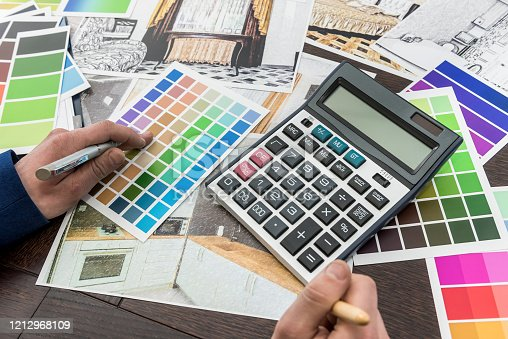 895150806 istock photo Home designer work at office house sketch with color catalog for dream modern renovation apartment. Archtecture house plan and color sample 1212968109