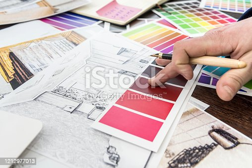 895150806 istock photo Home designer work at office house sketch with color catalog for dream modern renovation apartment. Archtecture house plan and color sample 1212977013