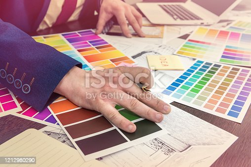 895150806 istock photo Home designer work at office house sketch with color catalog for dream modern renovation apartment. Archtecture house plan and color sample 1212980290