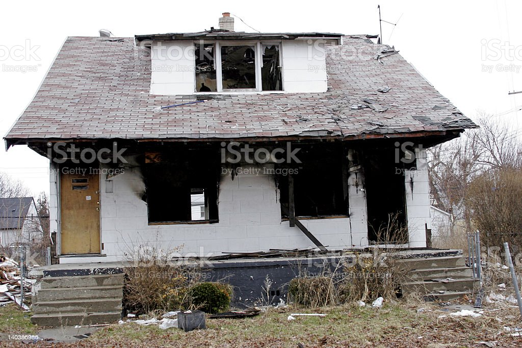 Home destroyed by arson fire stock photo