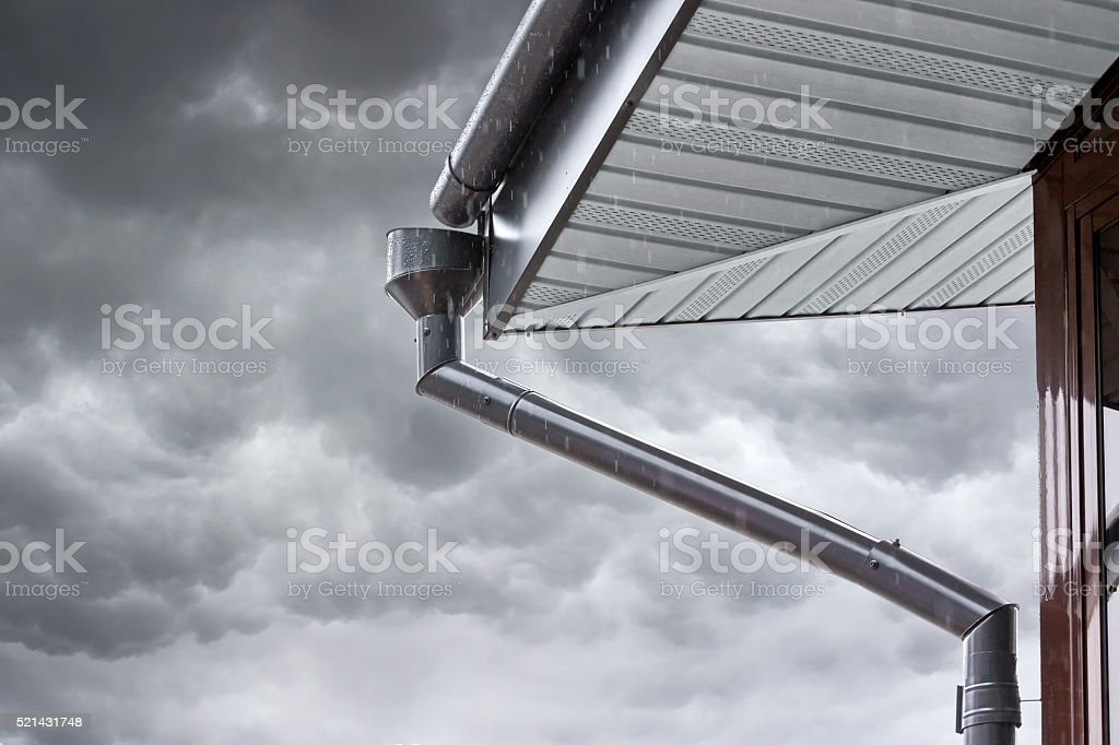 home drainpipe during rain stock photo
