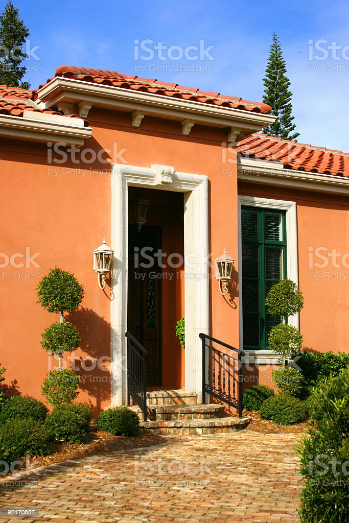 Home Entrance with Topiary Trees royalty-free stock photo