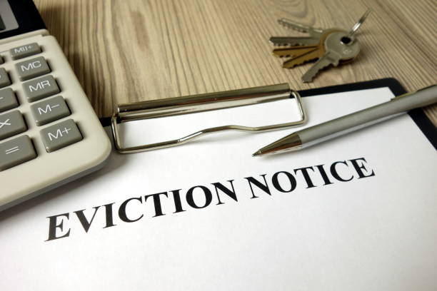 Home eviction notice legal document with pen calculator and keys stock photo