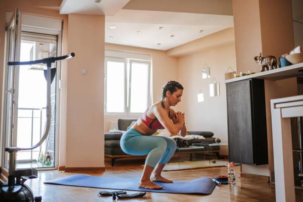 Home exercising stock photo