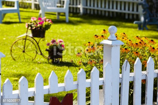 Home fences with flower beds.