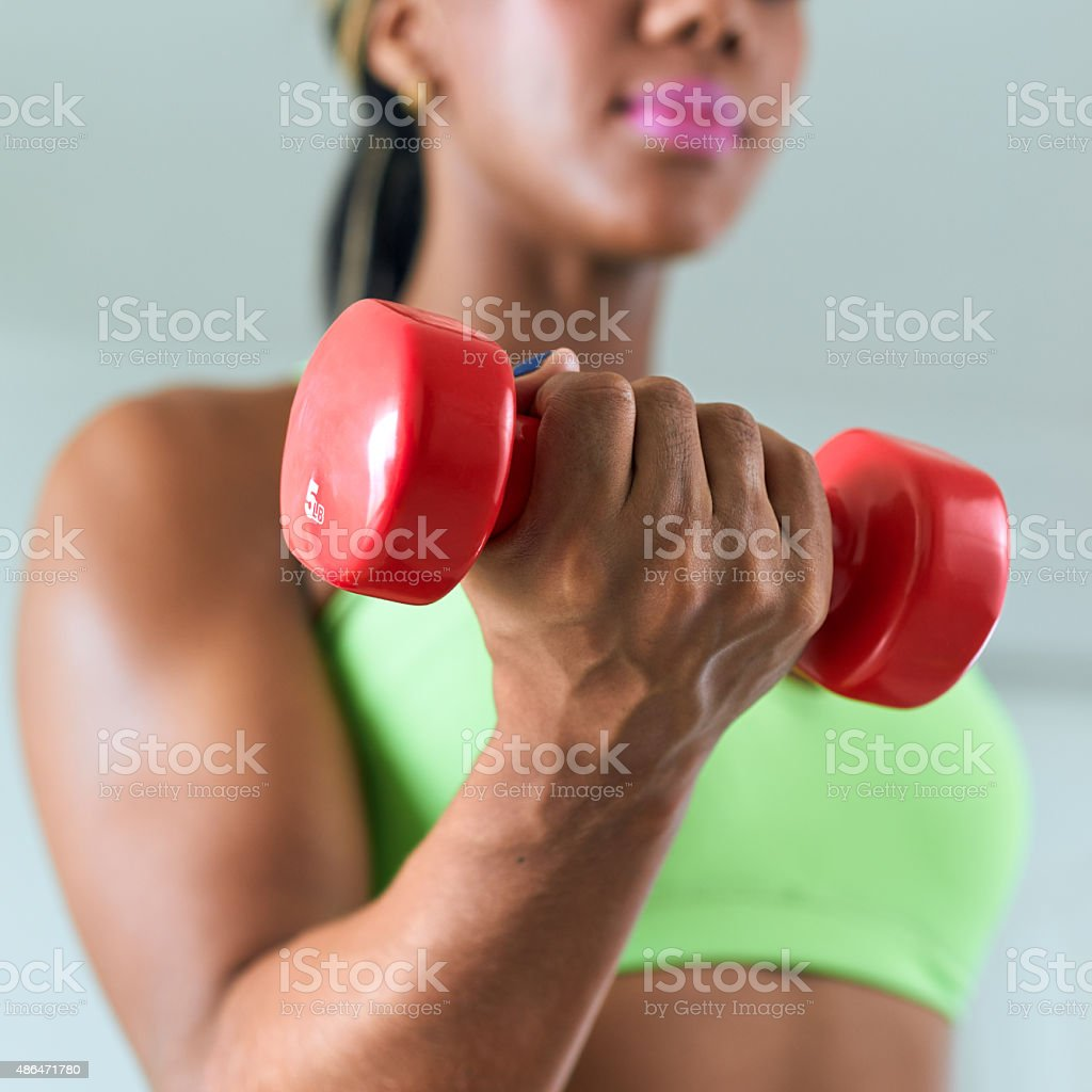 Home Fitness Black Woman Training Biceps With Weights-3 stock photo