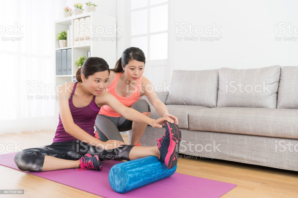 home fitness tutor woman teaching her student stock photo