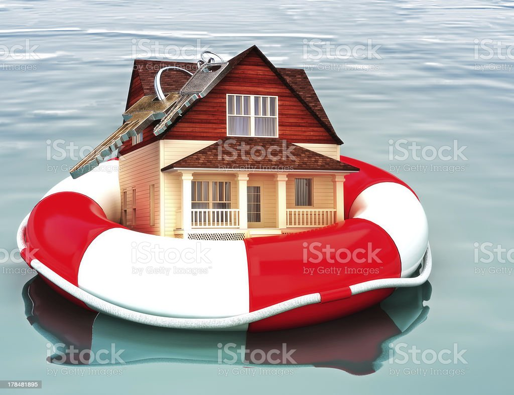 Home floating on a life preserver. stock photo