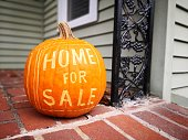 istock Home For Sale Sign - Fall 1050933328