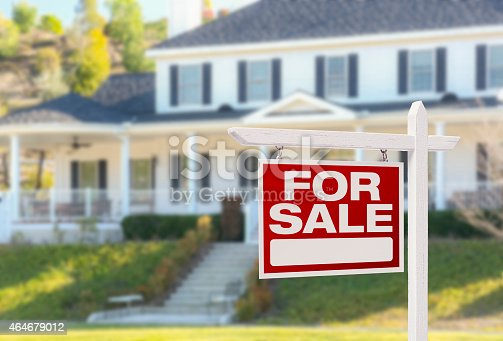 istock Home For Sale Sign in Front of New House 464679012