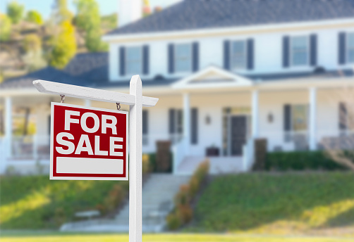 Home For Sale Sign In Front Of New House Stock Photo - Download Image Now