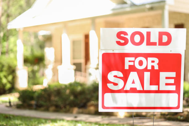 Home for sale with real estate sign. stock photo