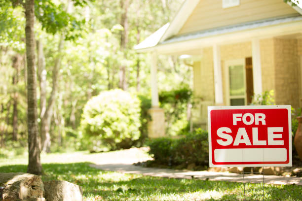 home for sale with real estate sign. - selling stock pictures, royalty-free photos & images