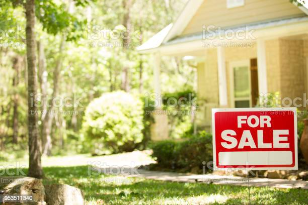 Photo of Home for sale with real estate sign.