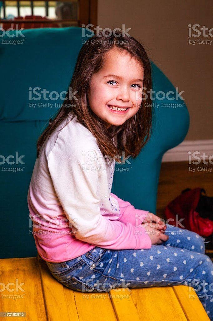 Home from School Six-year-old Girl Smiles at Camera royalty-free stock photo
