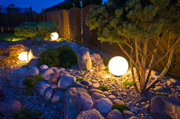 Home garden at night, illuminated by globe shaped lights Home garden at night, illuminated by globe shaped lights. Decorative gardening and landscaping abstract. illuminated stock pictures, royalty-free photos & images