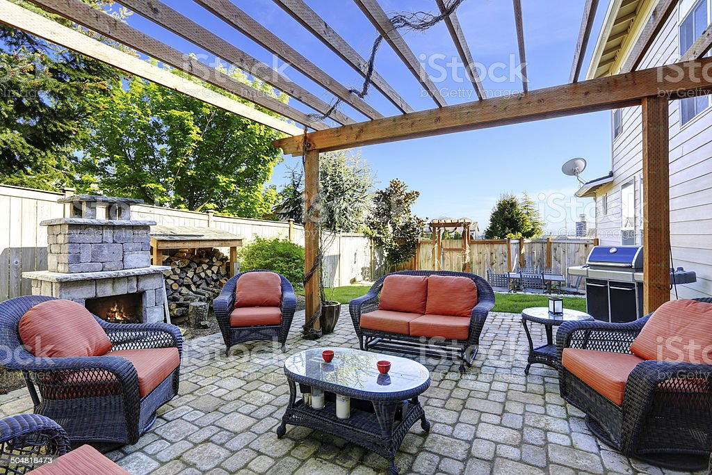 Home garden with patio area and fireplace stock photo