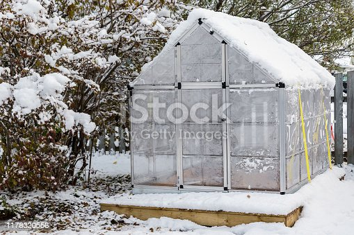 Little back yard home greenhouse in the snow.
