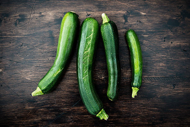 home grown courgettes stock photo