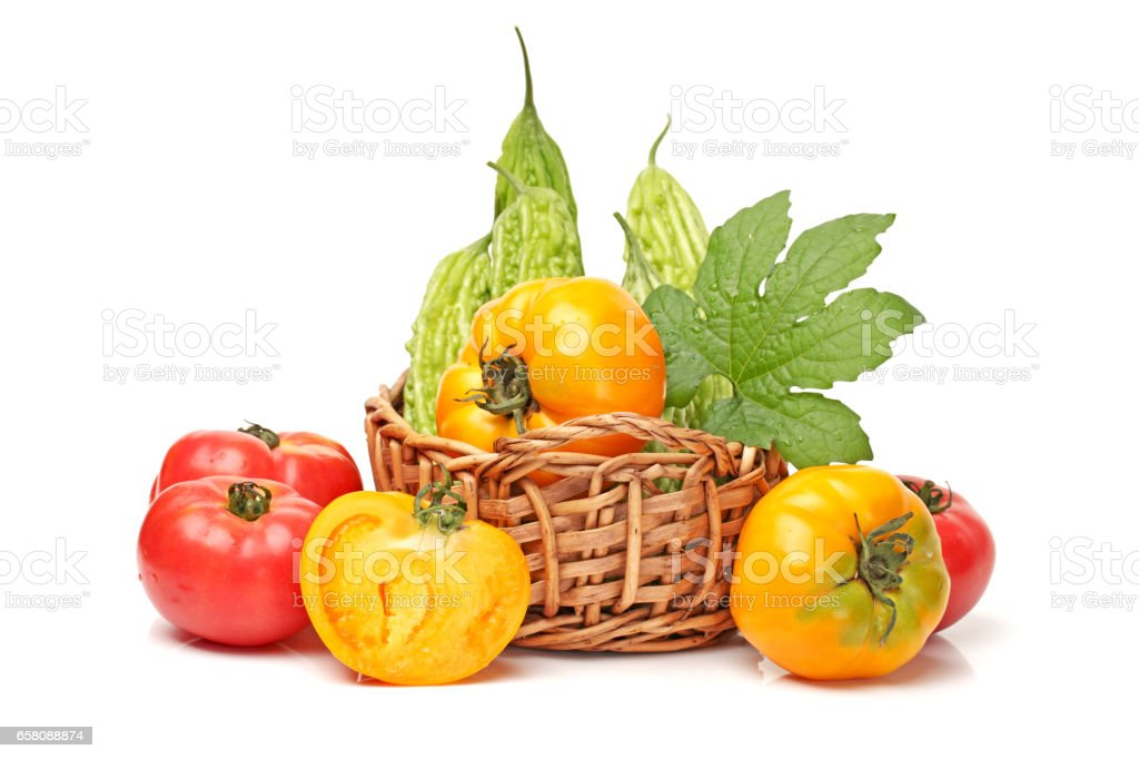 Home grown  tomatoes and   Balsam pear  on white background royalty-free stock photo