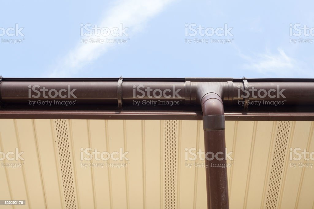 Home Guttering, Gutters, Plastic Guttering System, Guttering & Drainage Pipe Exterior against blue sky stock photo