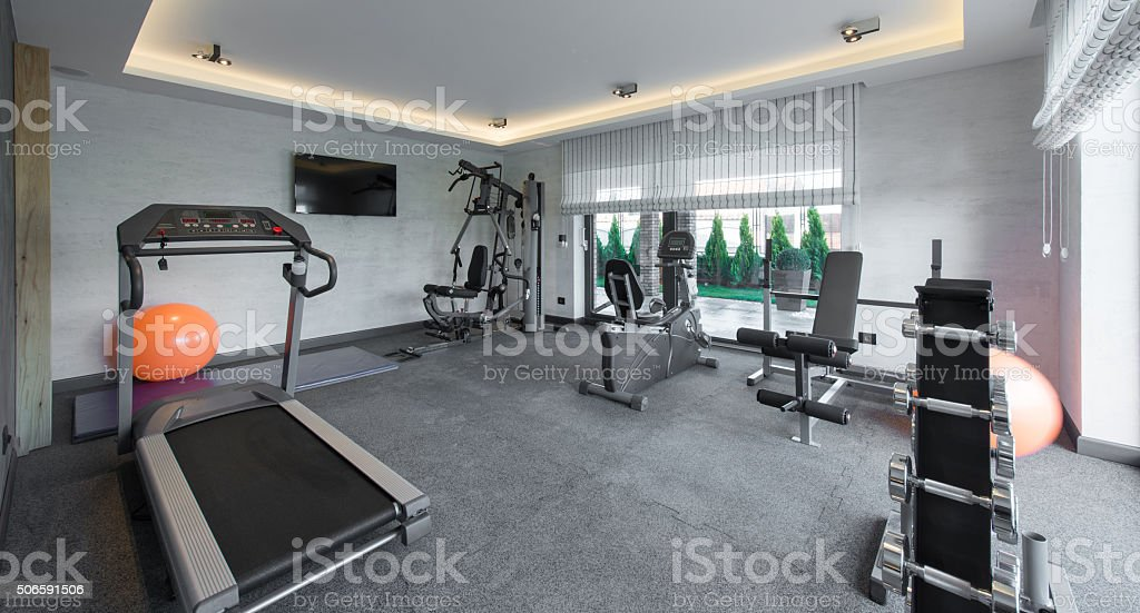 Home gym in luxury villa house stock photo