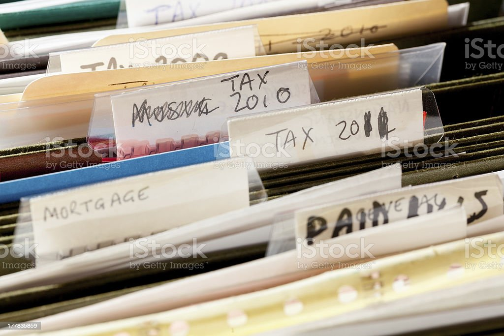 Home handmade file folders for tax papers stock photo