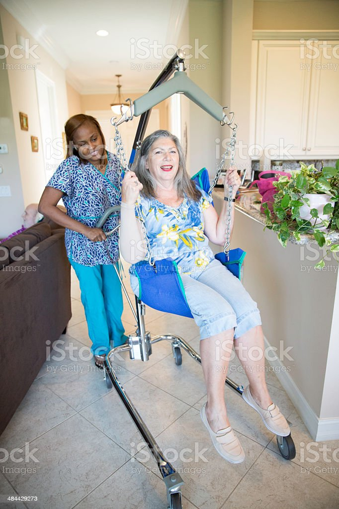 Home health aide and patient royalty-free stock photo