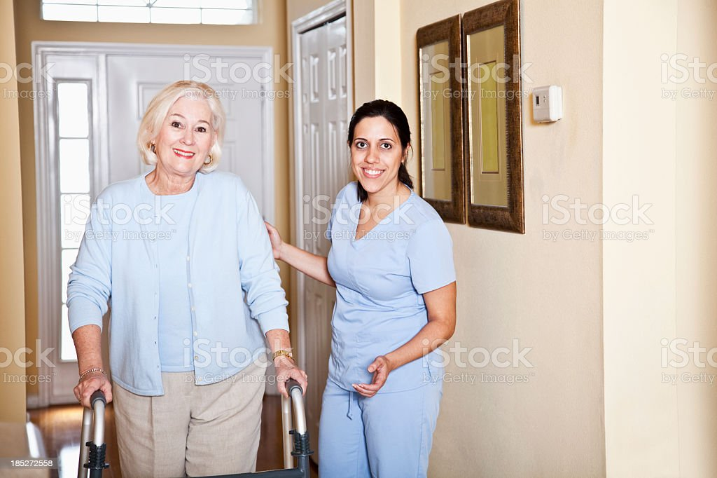 Home Health Aide >> Home Health Aide With Senior Woman Stock Photo Download