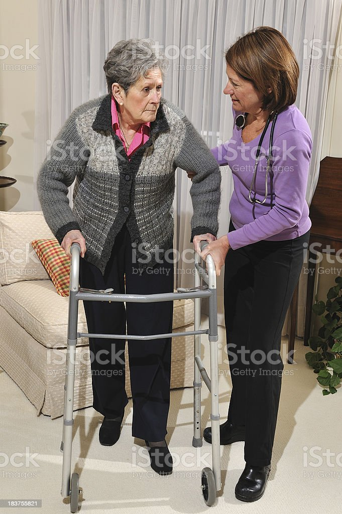 Home Health Care Worker Assists Senior Woman royalty-free stock photo