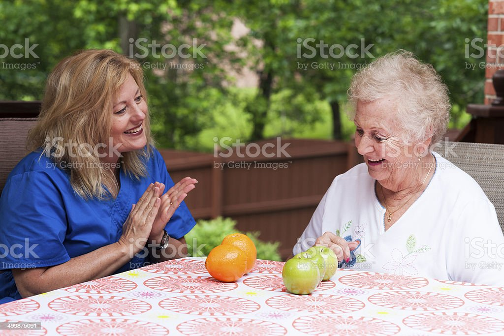 Home health speech therapy session outdoors stock photo