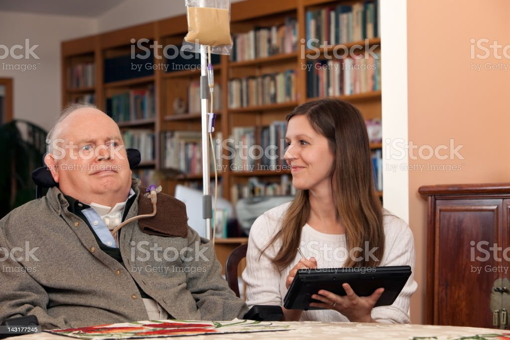 Home  Healthcare Nurse and Patient Exchange Smiles stock photo