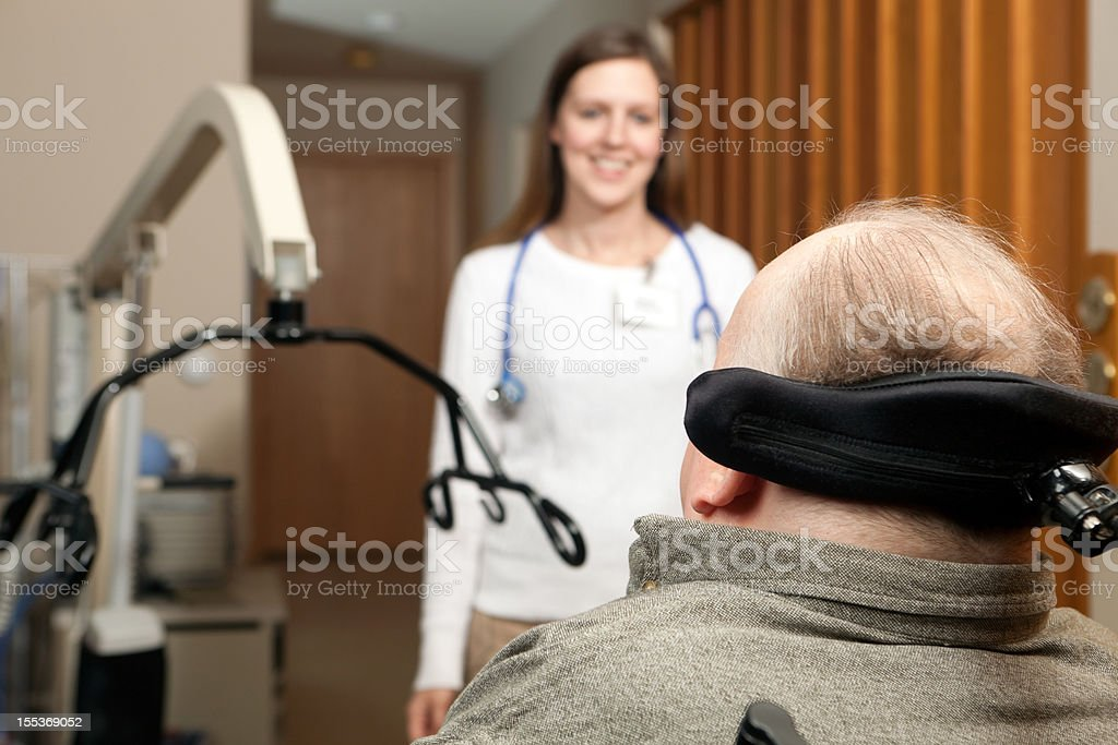 Home Healthcare Nurse Approaches a Patient stock photo