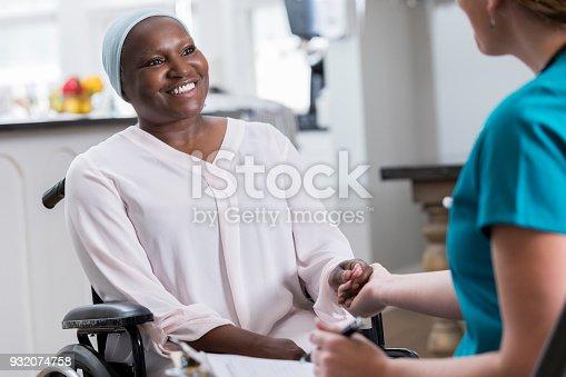 932074762istockphoto Home healthcare nurse greets senior patient 932074758