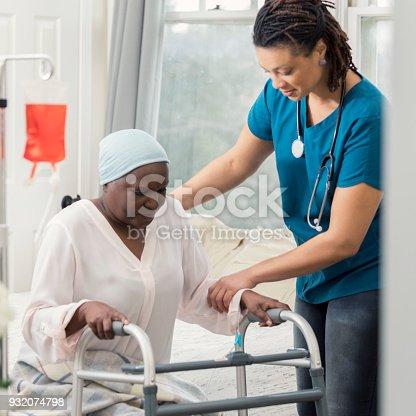 958891774istockphoto Home healthcare nurse helps patient with walker 932074798