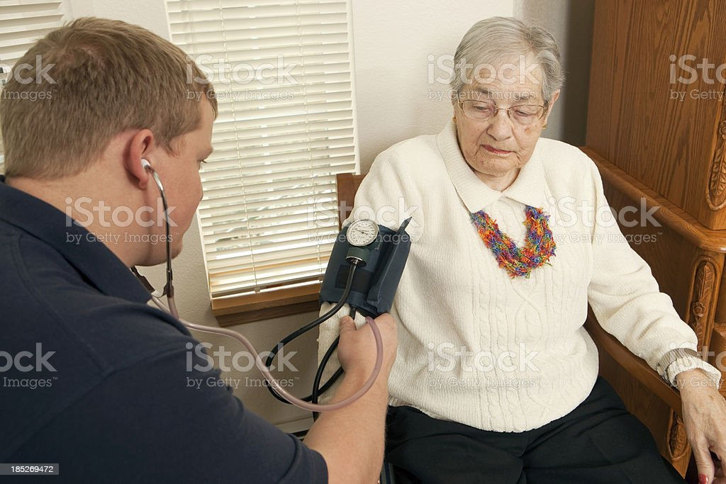 Home Healthcare Worker Checking Blood Pressure of Senior Patient royalty-free stock photo