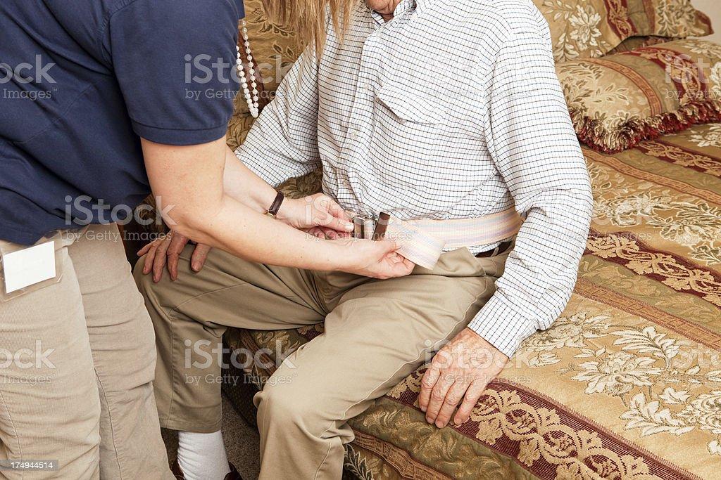 Home Healthcare Worker Fastening Gait Belt stock photo