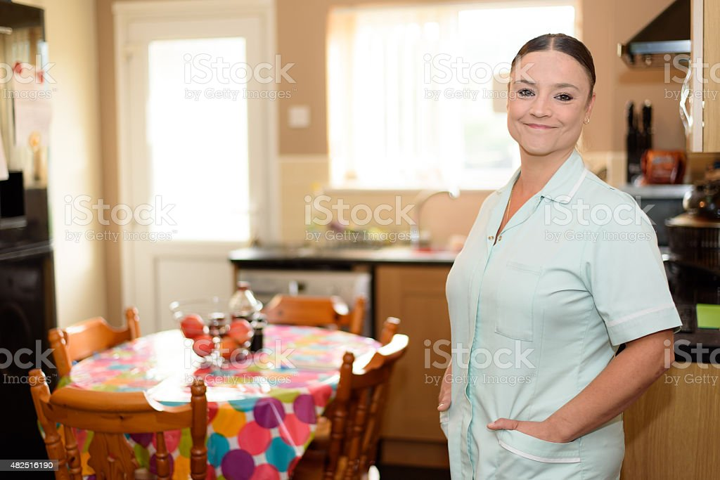Home healthcare worker in Patients Kitchen stock photo