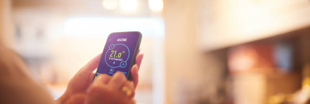 Home heating app Smart Home heating controls app smart thermostat stock pictures, royalty-free photos & images