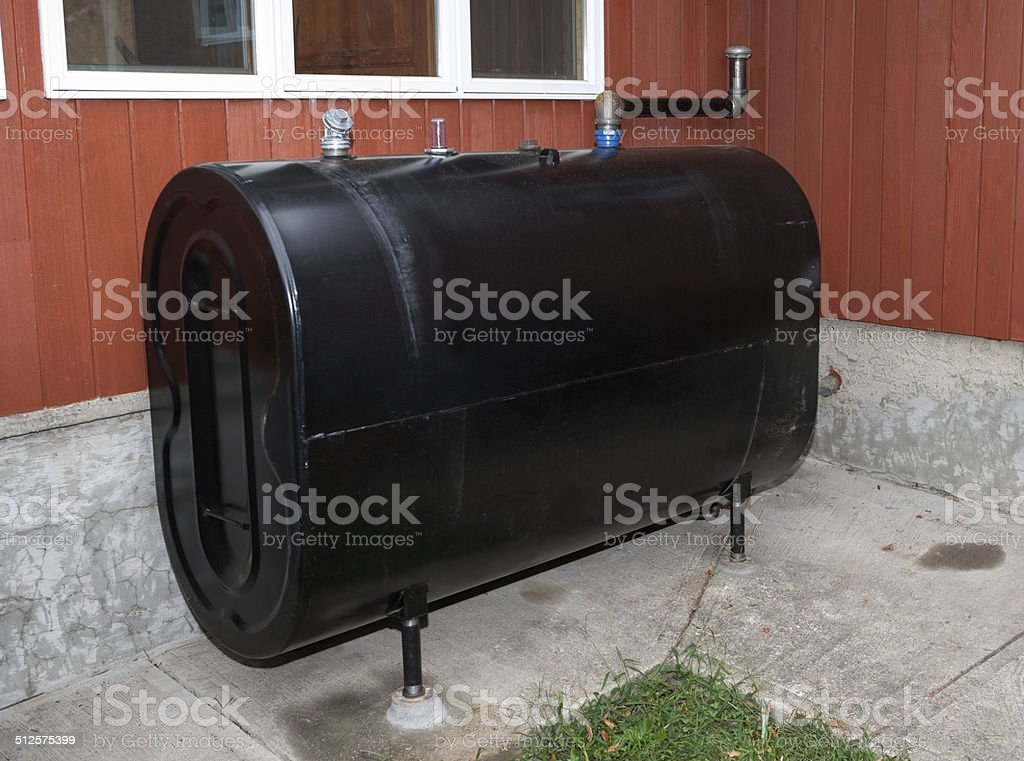 Home heating oil storage tank stock photo
