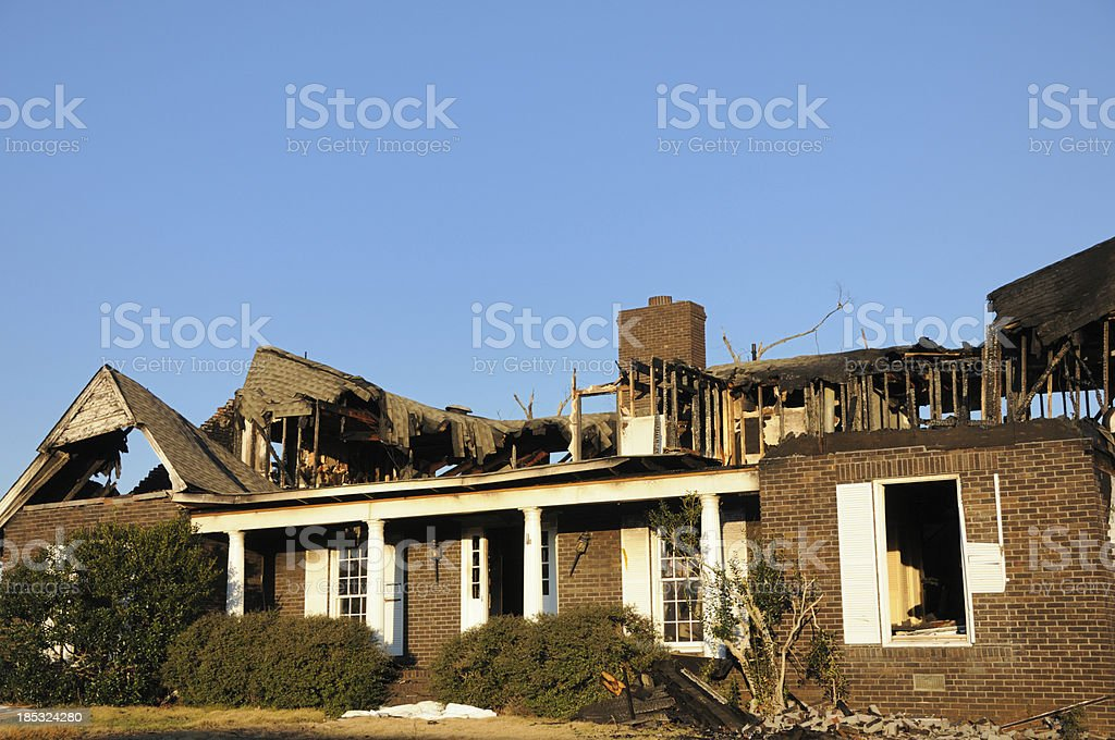 Home heavily damaged by fire stock photo