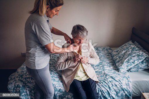 istock Home Help for Senior Woman at Home 665805054
