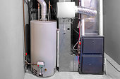 istock A home high efficiency furnace with a residential gas water heater & humidifier. 1276358762