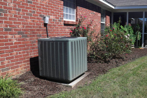 Home HVAC Unit next to modern brick home. Air Conditioner system next to a home, modern clean with bushes and brick wall equipment stock pictures, royalty-free photos & images