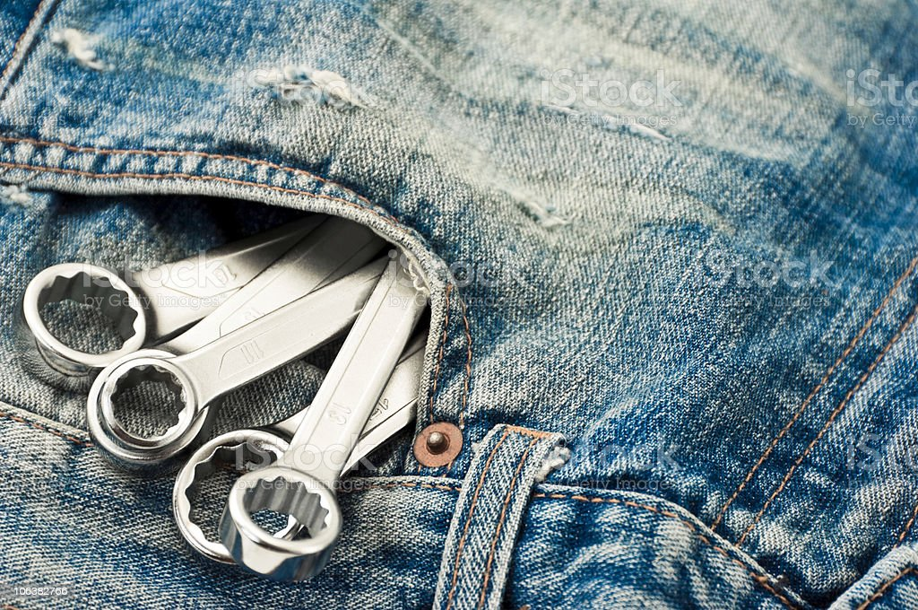 Home Improvement in  Jeans. Color Image royalty-free stock photo