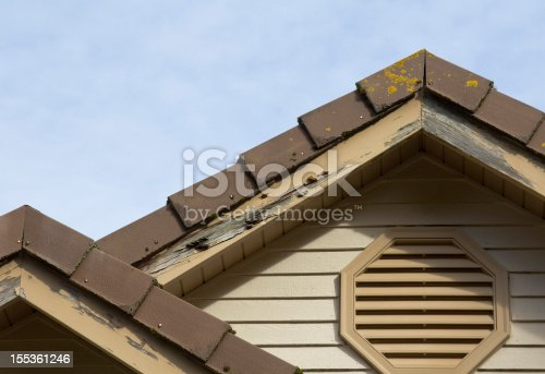 Wood fascia boards now rotten, termite ridden and in need of home improvement.