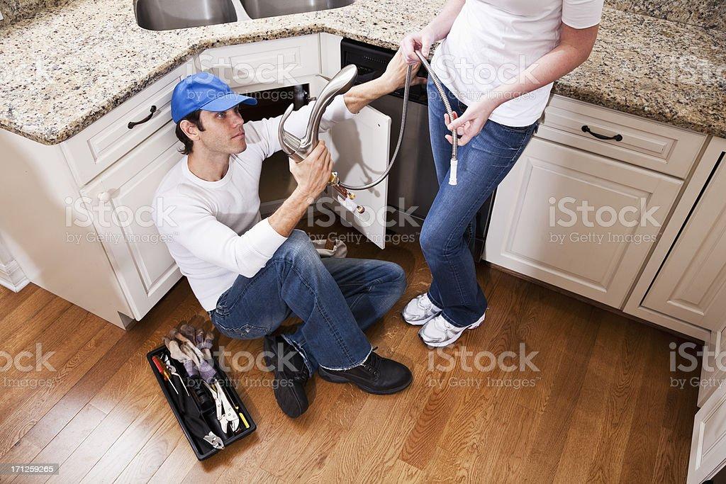 Home improvement - new kitchen faucet stock photo